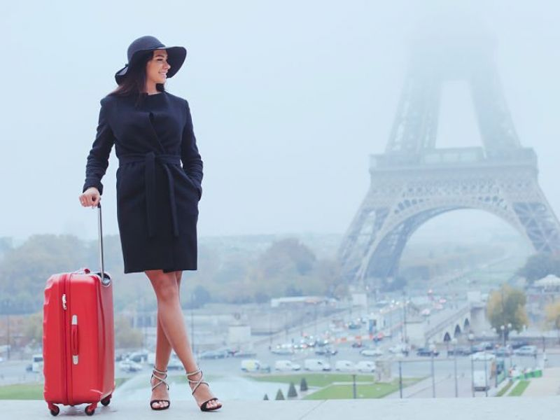 Tourist with luggage in Paris